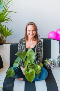 Nikki holding a plant